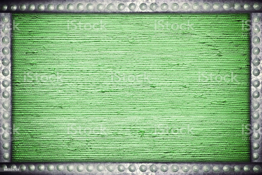 Old green fabric background with metal rivets frame stock photo