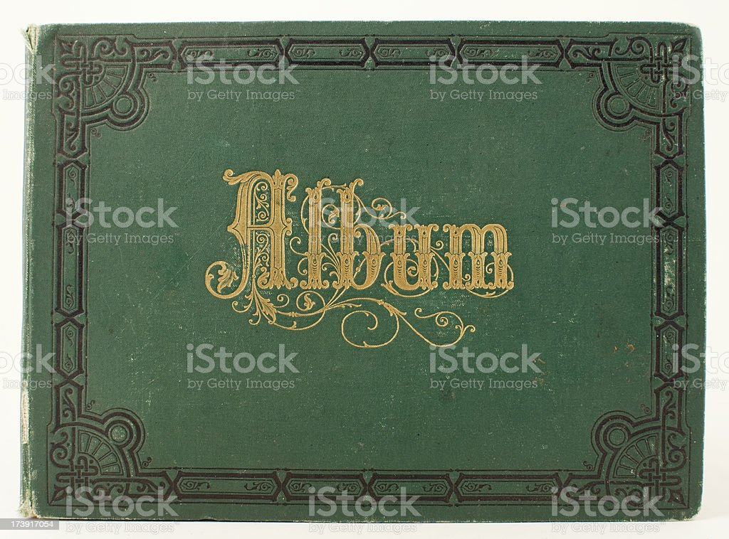 Old, green grungy Victorian album with gilded letters and decoration. royalty-free stock photo