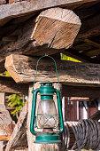 Old green kerosene lamp hanging in garden, Safranbolu, Turkey