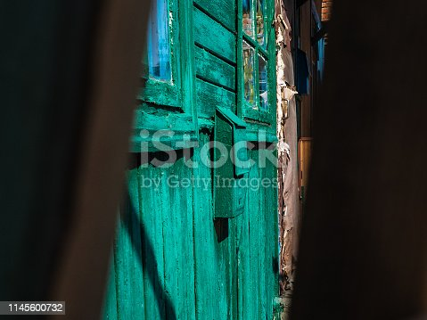 472273278 istock photo Old, green mailbox on a wall of the wooden house 1145600732