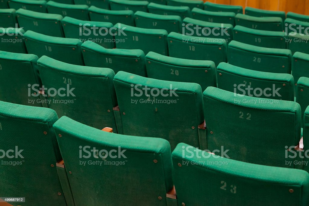 old green seats in cinema stock photo