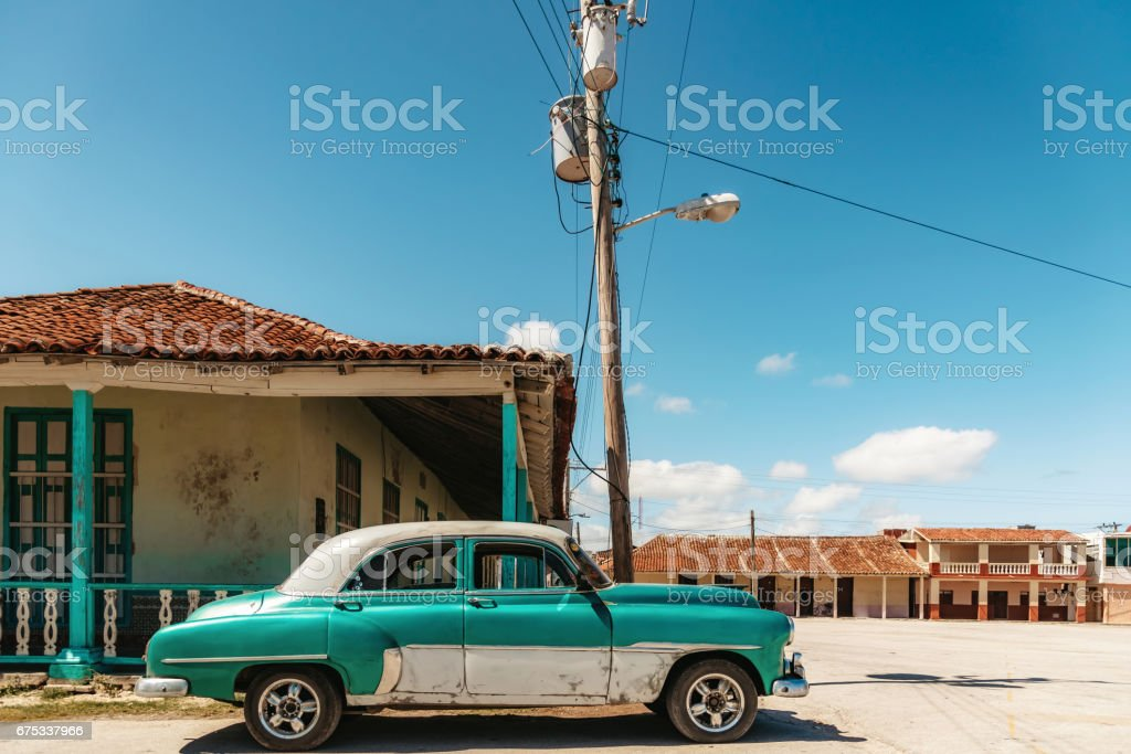 old green vintage car in the streets of Gibara in Cuba stock photo