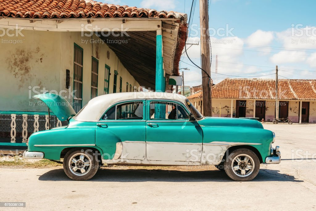 old green vintage taxi car in the streets of Gibara in Cuba stock photo