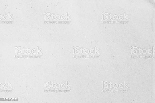 Photo of Old grey eco drawing paper kraft background texture in soft white light color concept for page wallpaper design, gray rice matte pattern for decorative wall.