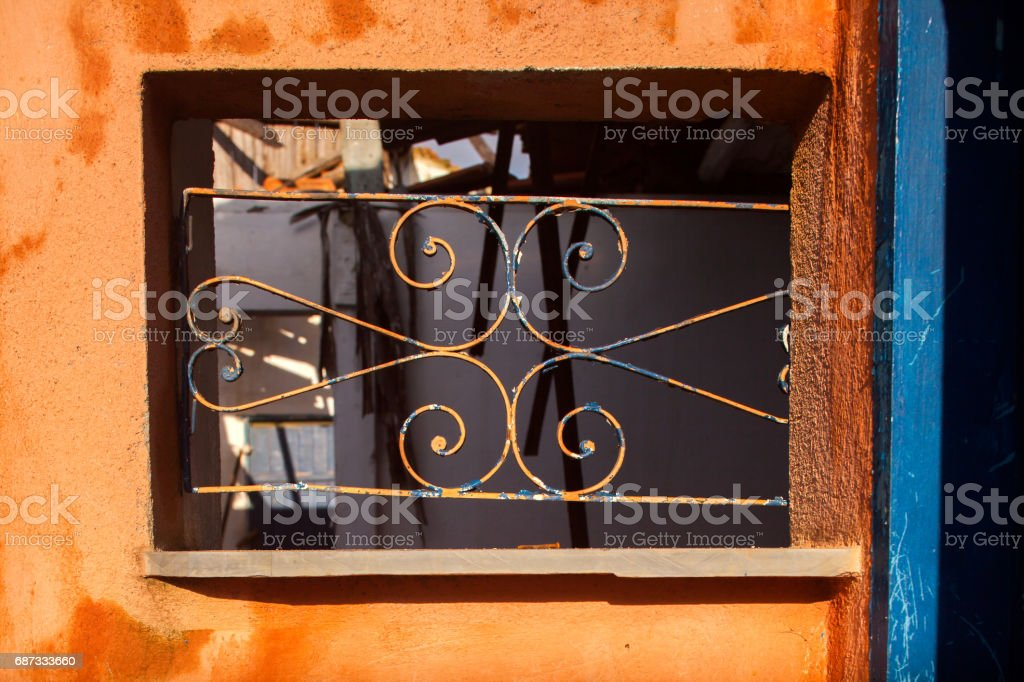 Old grid window in abandoned house in countryside stock photo