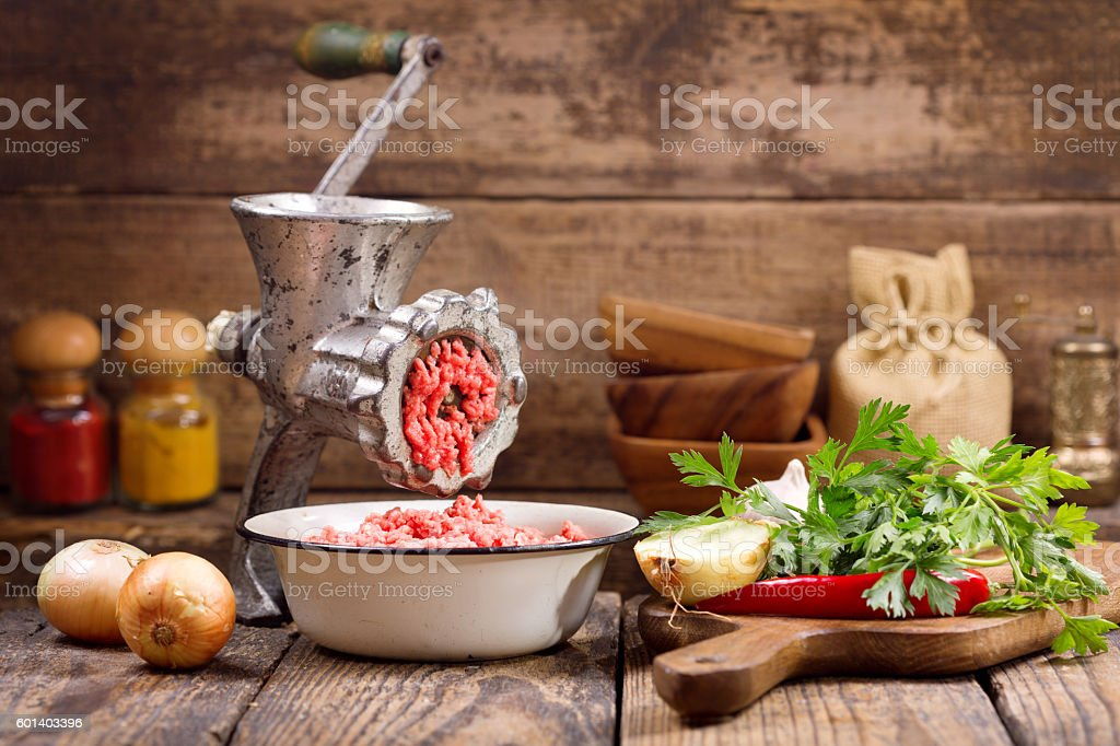 old grinder with minced meat stock photo