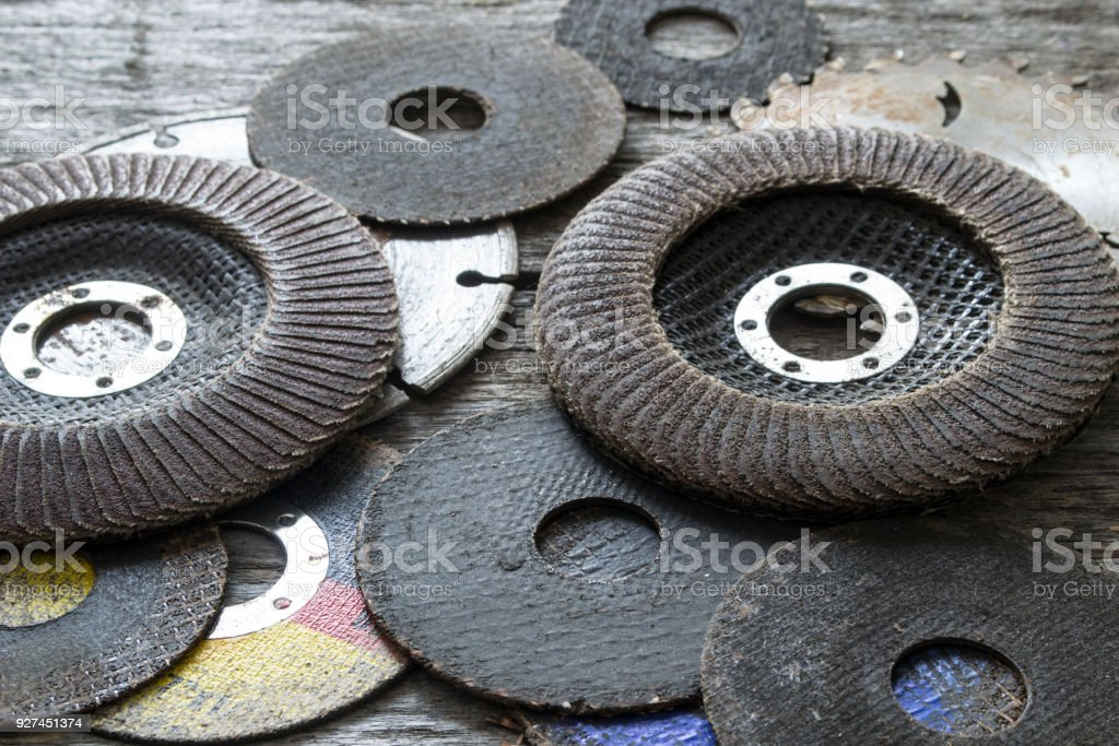 Old grinding discs on a wooden table. stock photo
