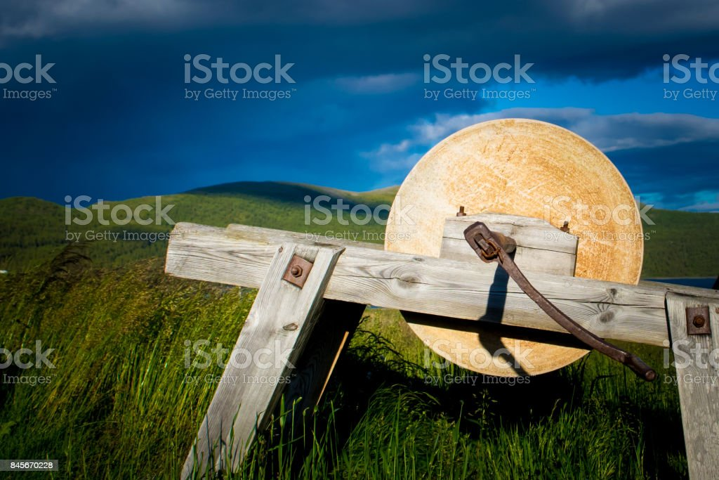Old grinding stone for grinding tools stock photo