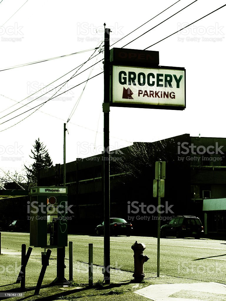 Old Grocery and Parking Sign on Street royalty-free stock photo