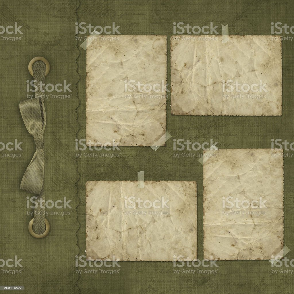 Old grunge album for photos with ribbon and bow stock photo