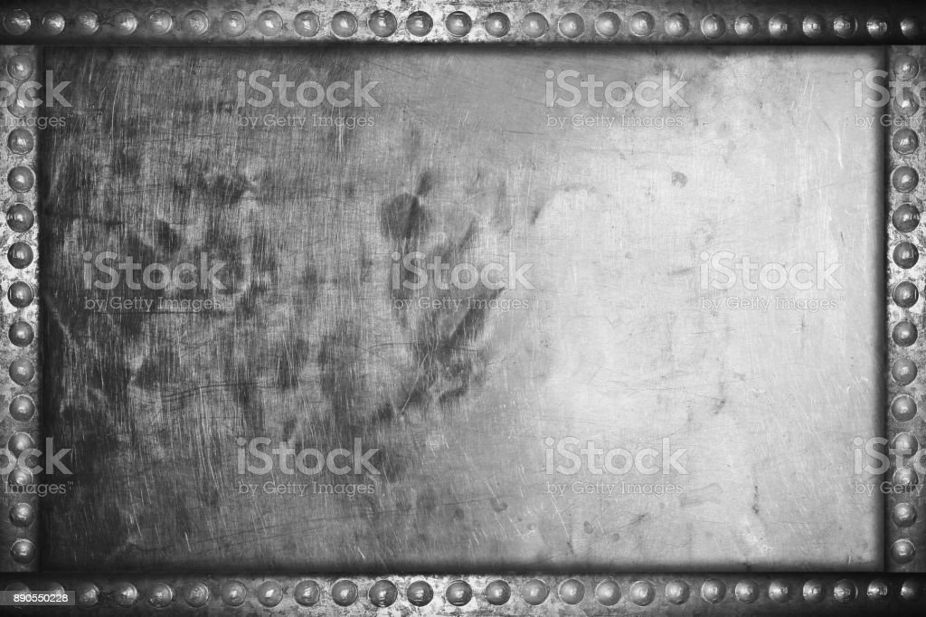 old grunge aluminum plate background with metal rivets stock photo