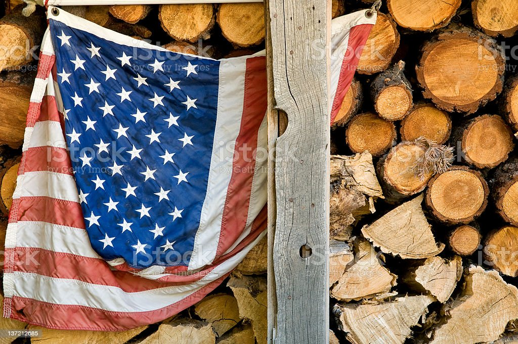 Old grunge american flag against firewood background royalty-free stock photo
