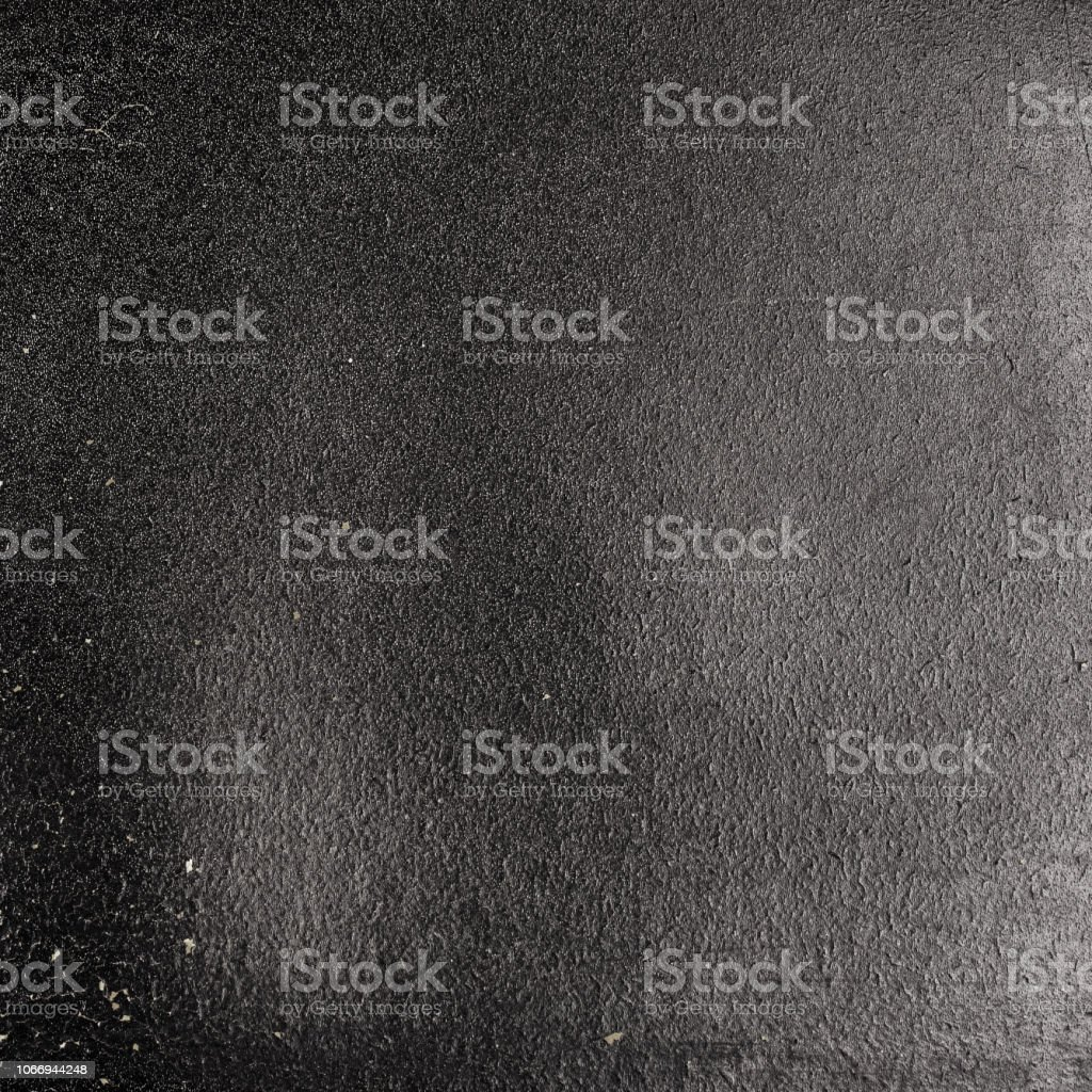 Old grunge black paper with paint peeling of. stock photo