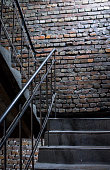 The wall is made of red brick The stairs is made of cement This wall is popular in English style Also known as a vintage style.as background with copy space