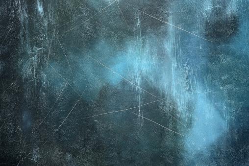 Old grunge dark blue background looks like an ice.