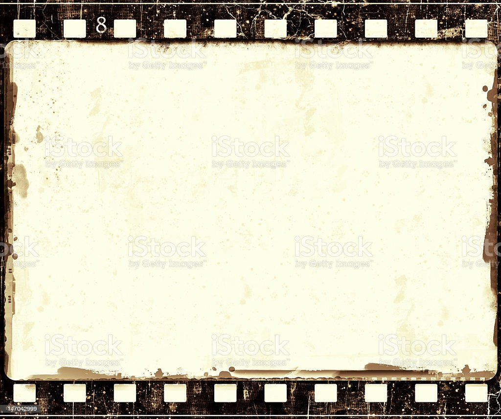 Old grunge film frame with the number 8 printed royalty-free stock photo