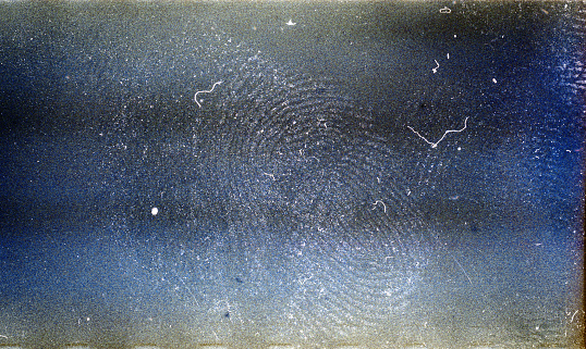 Blank grained film strip texture background with heavy grain, dust fingerprint and newton's rings
