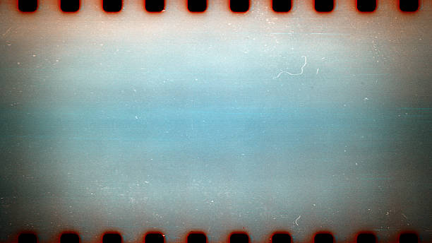 Old grunge filmstrip Blank grained film strip texture background with heavy grain dust and scratches film negative stock pictures, royalty-free photos & images