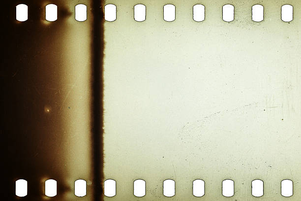 Old grunge filmstrip Blank yellow vibrant noisy film strip texture background photographic slide stock pictures, royalty-free photos & images