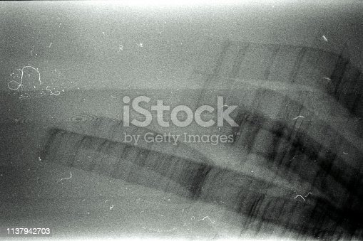 Blank grained film strip texture background with heavy grain, dust and newton rings