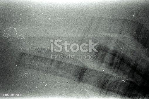 1126727680 istock photo Old grunge grainy filmstrip texture background 1137942703