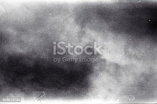 1143033009 istock photo Old grunge grainy filmstrip texture background 928913730