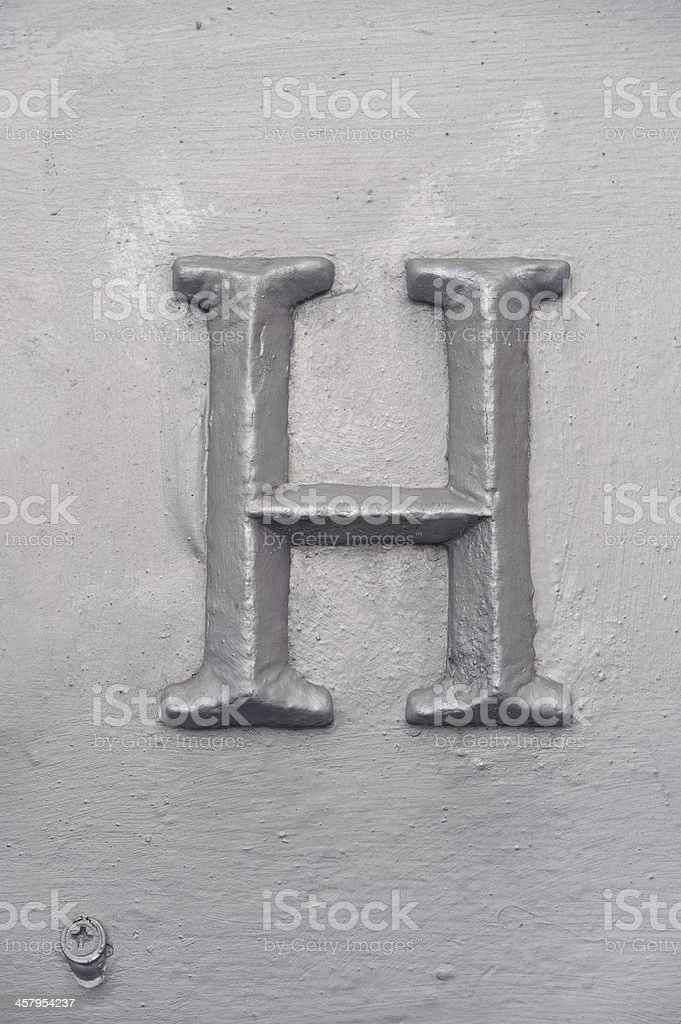 Old grunge letter H royalty-free stock photo