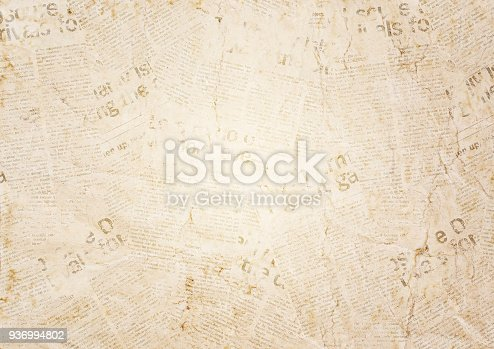 istock Old grunge newspaper texture background 936994802