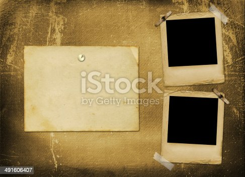 istock Old grunge paper slides on the ancient background 491606407