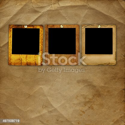 istock Old grunge paper slides on the ancient background 497509719