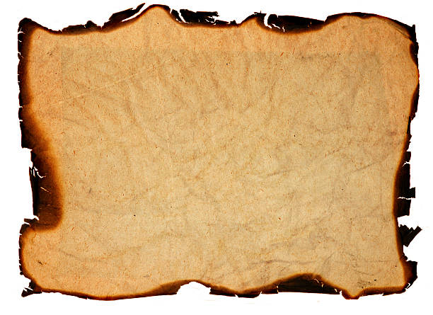 old grunge paper with burned edges - isolated stock photo