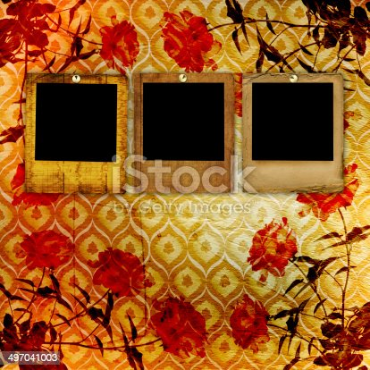 istock Old grunge torn frame on the ancient background with roses 497041003