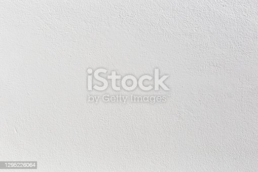 istock Old grunge white wall texture background. 1295226064