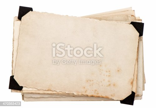 1129542015 istock photo Old grungy paper with black plastic corners 470353423