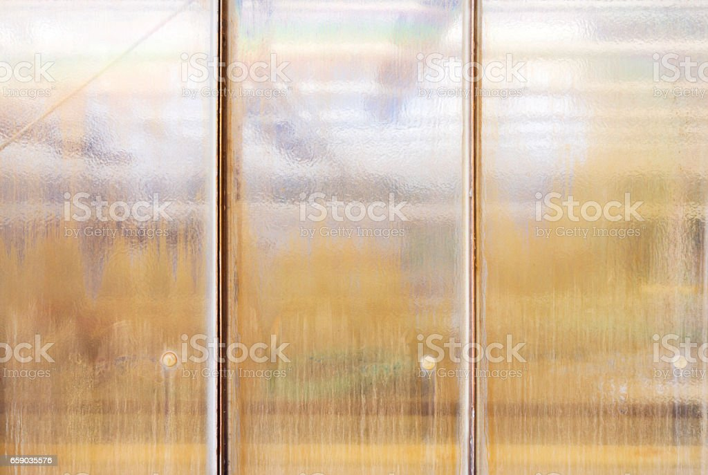 old grungy structural glass window for backgrounds stock photo