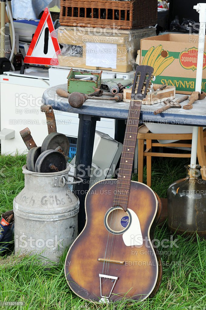 old guitar and milk canister at Flea Market royalty-free stock photo
