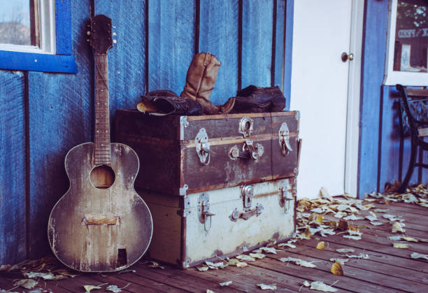 old guitar in the west - broken guitar stock photos and pictures