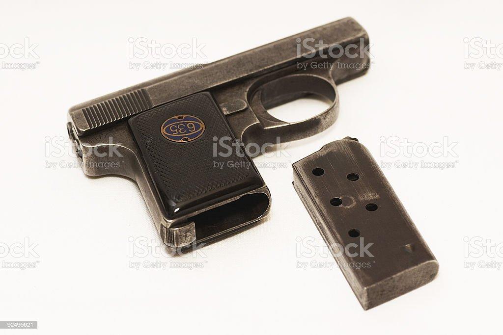 Old gun and a clip stock photo
