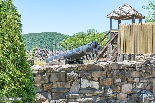Old gun on the carriage on the fortress wall
