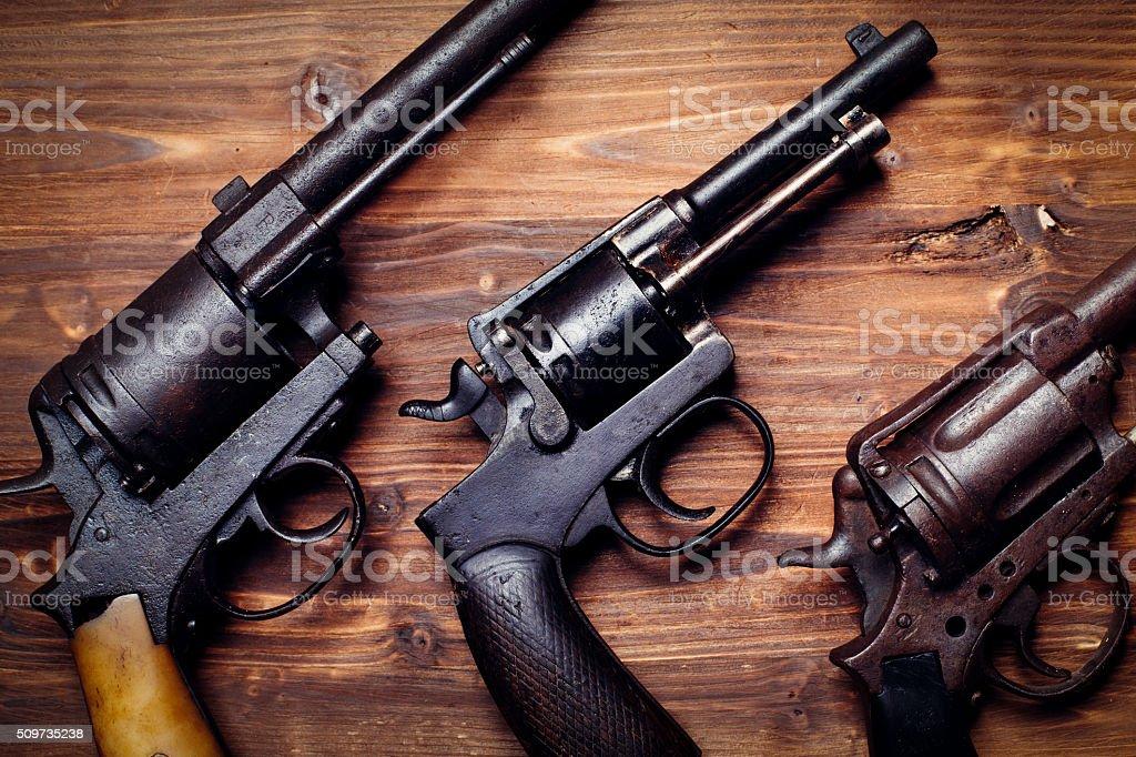 Old gun on wooden background stock photo