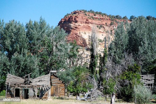 Decaying, abandoned, derelict and decrepit Old Gunsmoke movie set in Johnson Canyon near Kanab Utah now rotting in cattle pastures on a ranch
