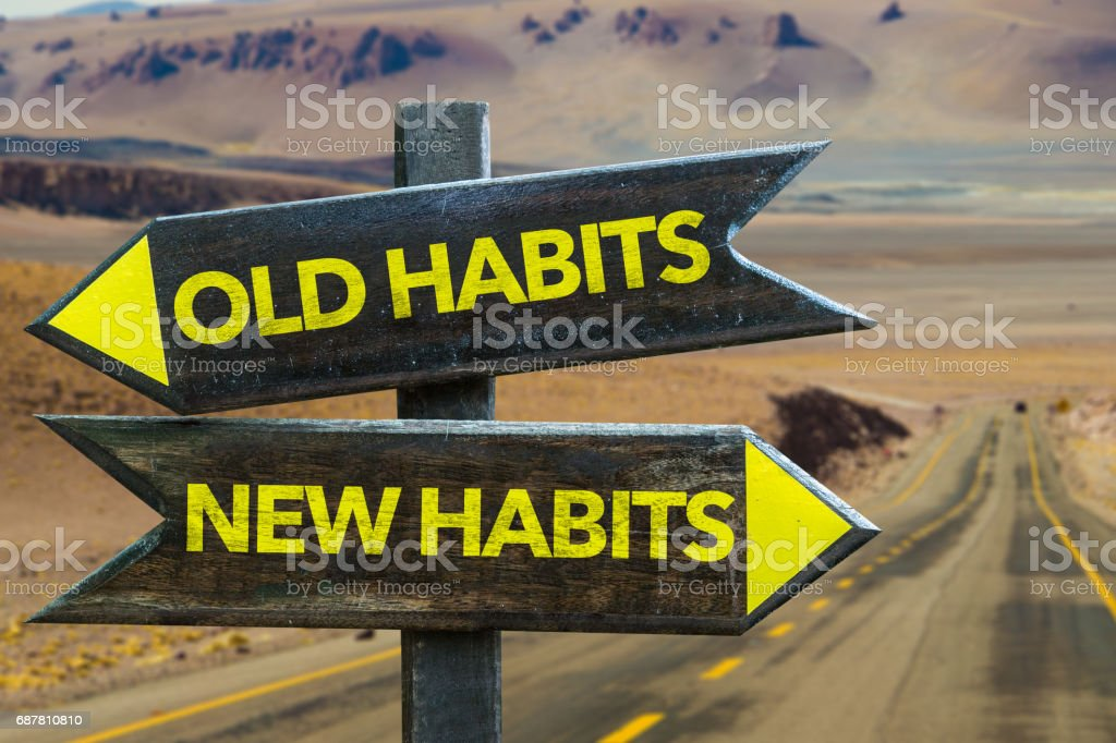 Old Habits - New Habits signpost stock photo