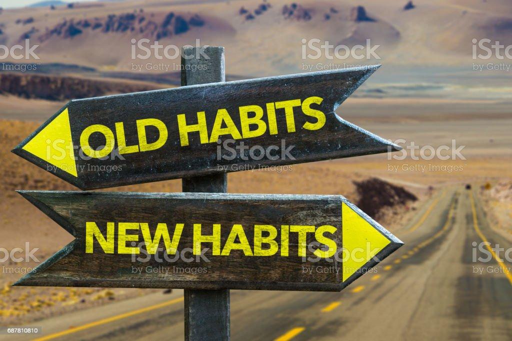 Viejos hábitos - nuevo cartel de hábitos - foto de stock