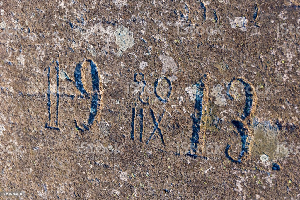 Old half-erased inscriptions, embossed on a granite rock. stock photo