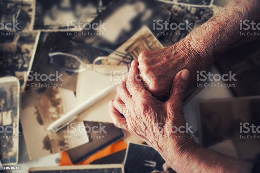 Old hand of grandmother with her memories stock photo