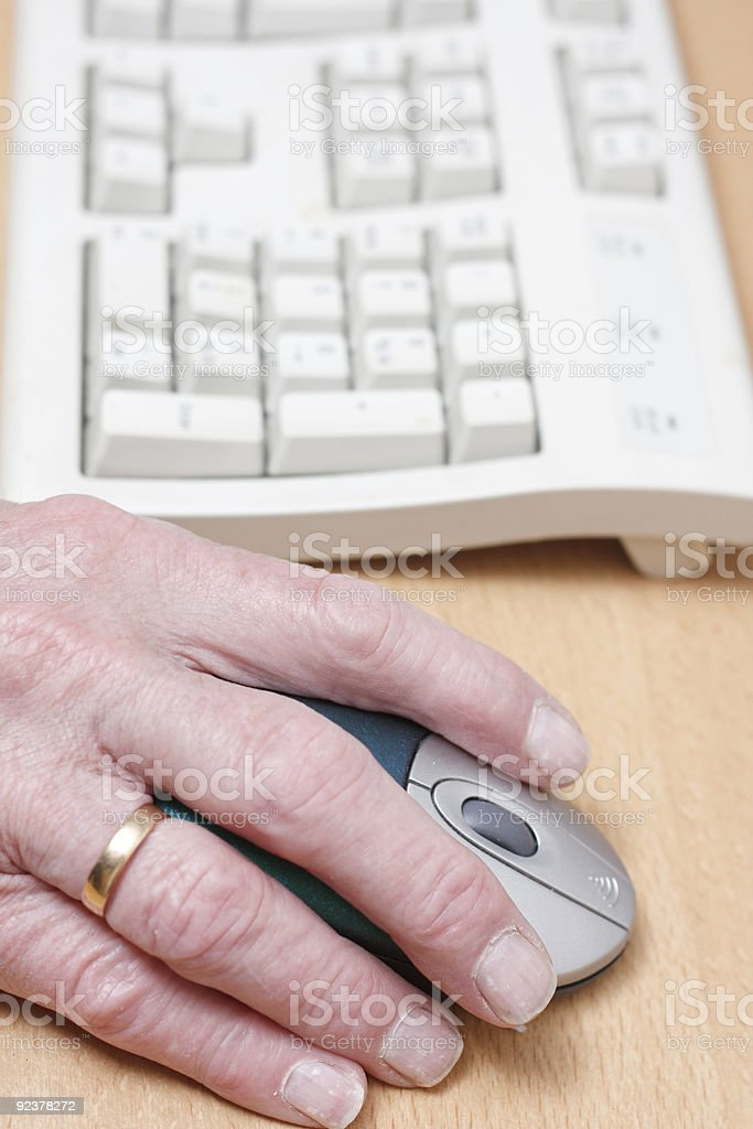 Old hand on a mouse royalty-free stock photo