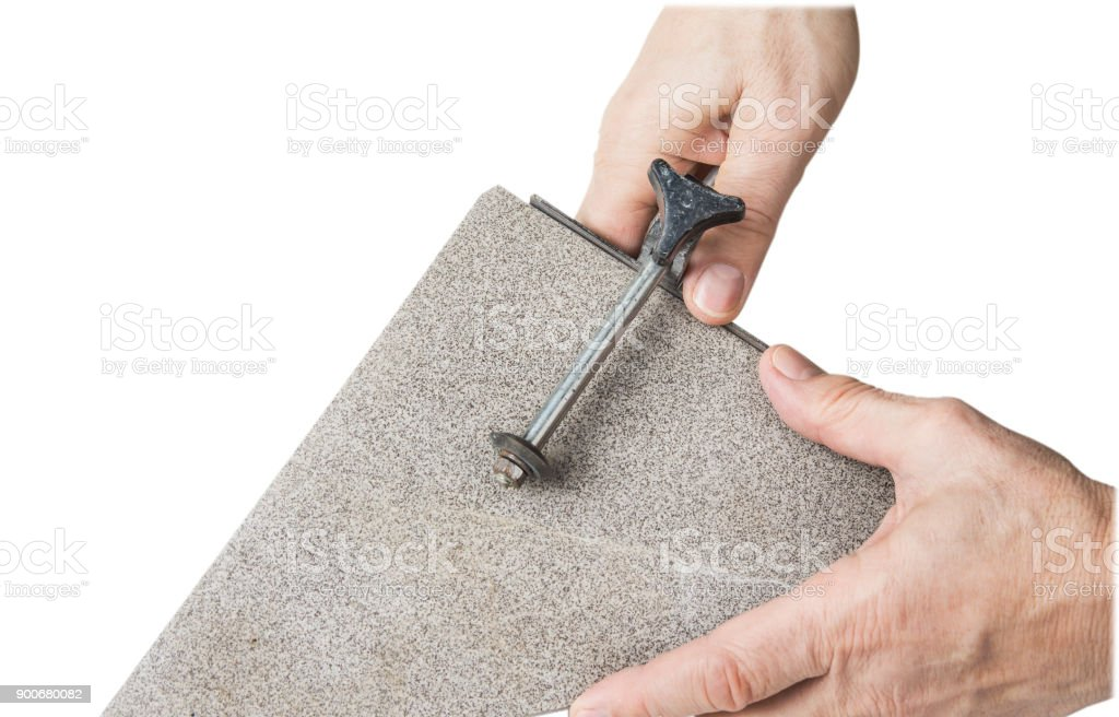 Old hand tile cutter for small repair on the white background stock photo