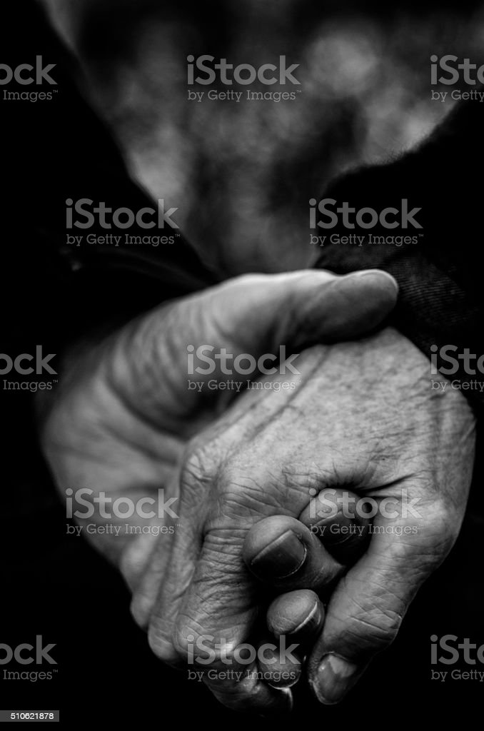 Old hands holding together, Monochrome Shot stock photo