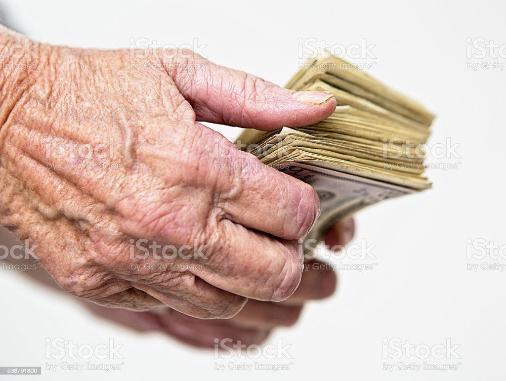 old hands, money, sheaf, dollars, wrinkled age, wealth stock photo