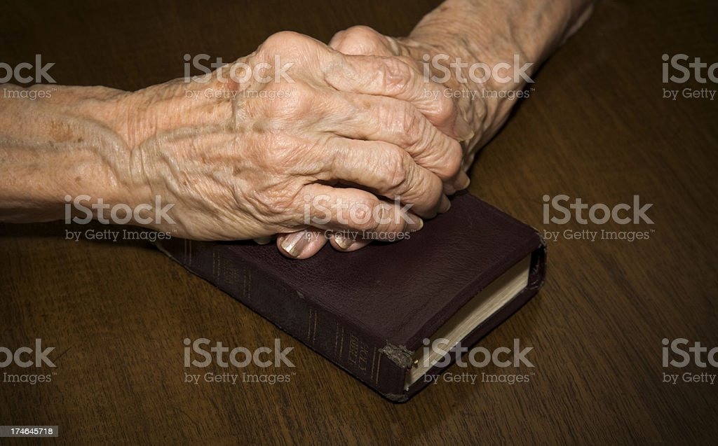 old hands of faith royalty-free stock photo